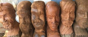 560 carved wooden heads